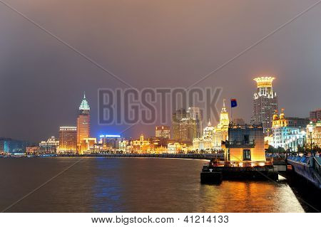 Shanghai urban architecture over river at dusk