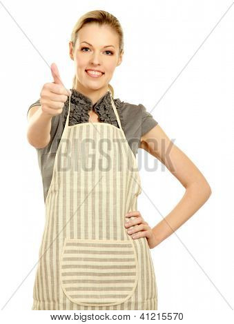 Beautiful happy young  woman wearing kitchen apron and gesturing thumbs up, isolated on white