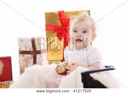 Beautiful baby girl on gifts scared