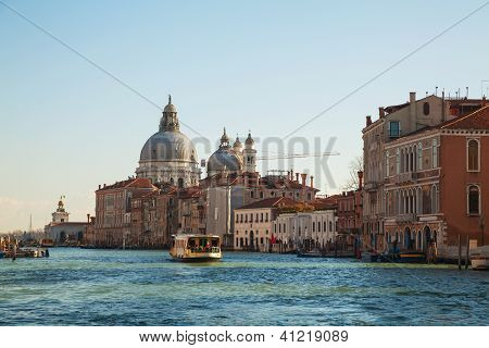 Basilica Di Santa Maria Della Salute With Vaporetto Floating At Grand Canal