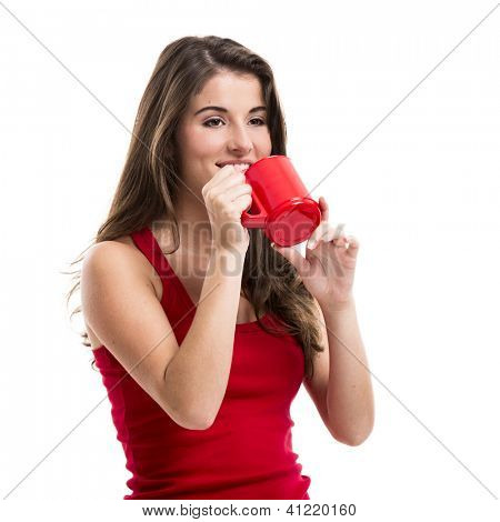 Beautiful young woman over a white background drinking a hot coffee
