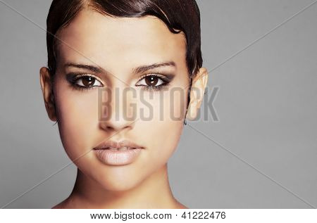 Beautiful young woman with short hair style and pretty eyes.