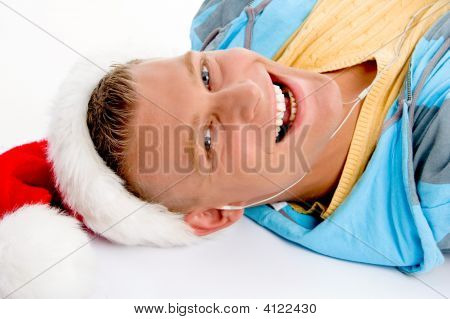 Smiling Young Man With Christmas Hat