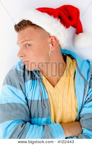 Man Wearing Christmas Hat And Listening Music