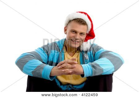 Sitting Young Male With Christmas Hat