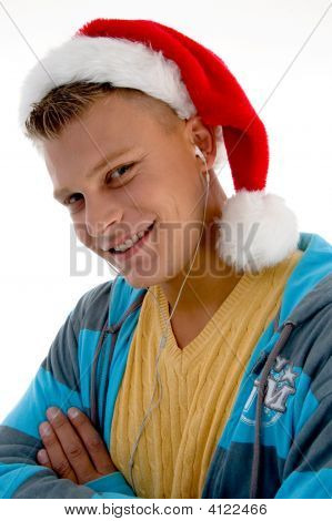 Side Pose Of  Man With Christmas Hat