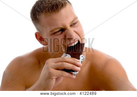 Muscular Guy Eating Chocolate