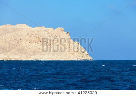 Sea With Stony Bare Mountain In The Background