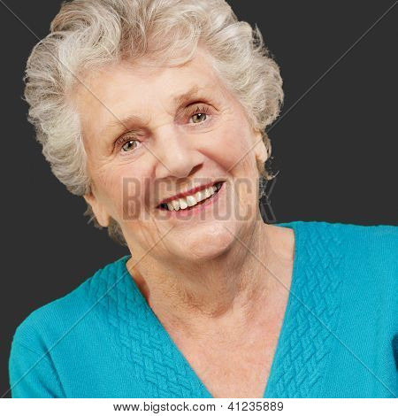 Portrait of happy senior woman isolated on black background