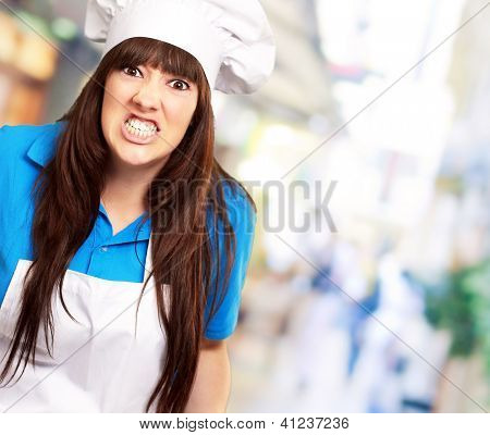 portrait of a female chef clenching, outdoor