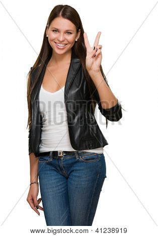 Young Woman Giving Victory Sign Over A White Background