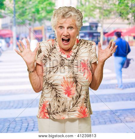 Portrait Of Shocked Senior Woman, Outdoors