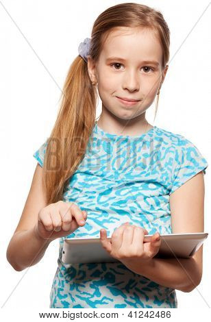 Child looks to the tablet computer. Kid with tablet isolated on white background
