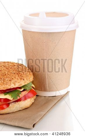 Appetizing sandwich with coffee in disposable cup isolated on white