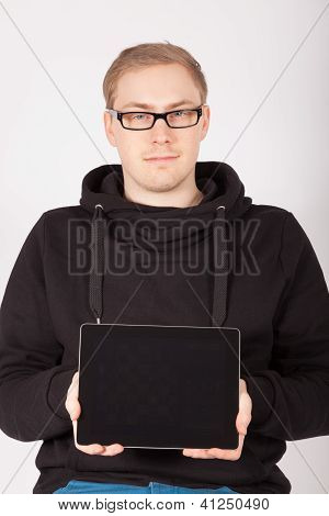 A Young Man Holds His Tablet Computer In The Camera