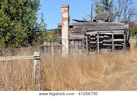 An abandoned building in tall grass
