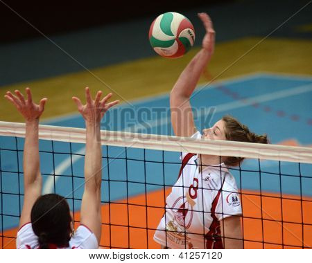 KAPOSVAR, HUNGARY - JANUARY 13: Timea Kondor (8) in action at the Hungarian I. League volleyball game Kaposvar (white) vs Budapest SE (white), January 13, 2013 in Kaposvar, Hungary.