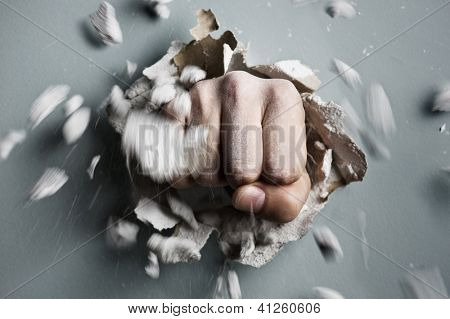 a wall is broken through by a fist