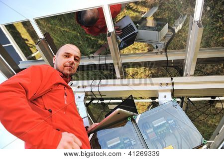 Engineer working with laptop fixing  solar panels
