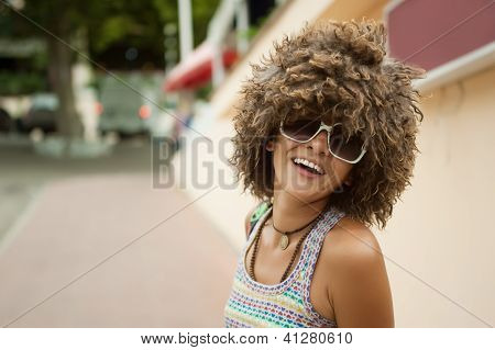 woman in a wig of curly hair