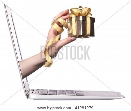 Hand With A Gift Come Out From A Screen Of A Laptop