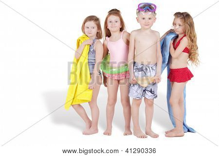 Group of four children in beach suits and with beach accessoires