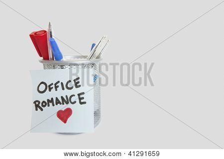 Conceptual image of sticky notepaper with heart shape depicting office romance