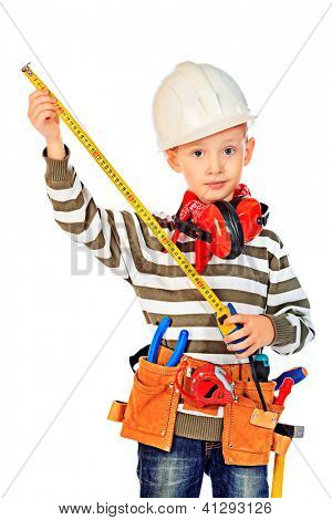 Little boy in a helmet plays in the builder with tools. isolated over white.