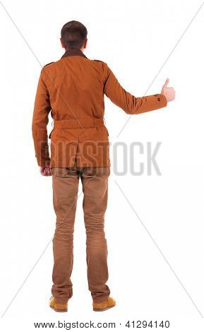 Back view of  man in jacket  shows thumbs up.   Rear view people collection.  backside view of person.  Isolated over white background.