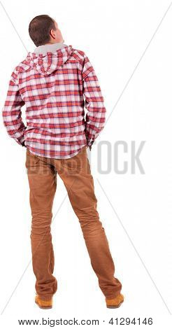 Back view of guy in a plaid shirt with hood  looking. Standing young man in jeans and  jacket. Rear view people collection.  backside view of person.  Isolated over white background.