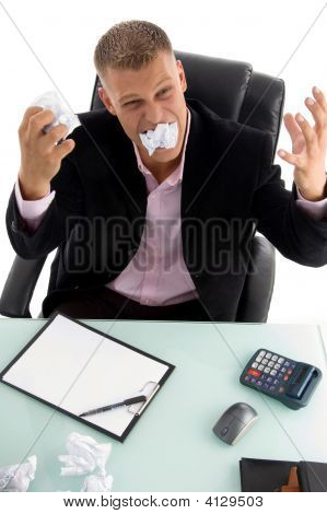 Young Angry Businessman With Papers