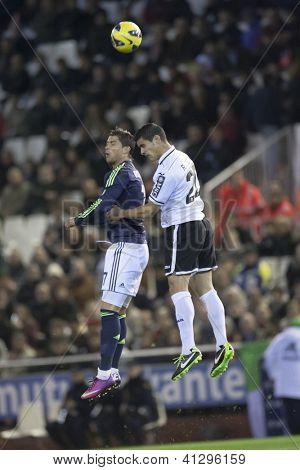 VALENCIA - JANUARY 20: Cristiano Ronaldo left and Ricardo Costa during Spanish Soccer League match between Valencia CF and Real Madrid, on January 20, 2013, in Mestalla Stadium, Valencia, Spain