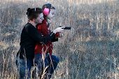 stock photo of mother law  - Mother teaching her young daughter how to safely and correctly use a handgun - JPG