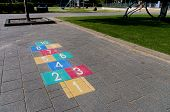foto of hopscotch  - colorful hopscotch game on a schoolyard in the netherlands - JPG