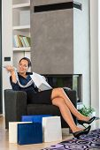 Woman looking clothes gift present living room interior domestic sale poster