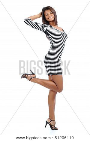 Beautiful Latin American Model With Long Legs Wearing A Dress Posing