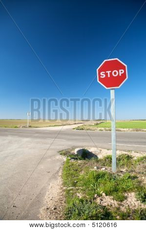 Stop Sign At Crossroads
