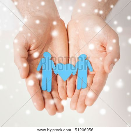 love, romance, human rights, gay, family concept - man hands showing two paper men with heart shape