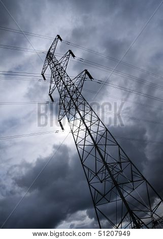 Pylon Or Transmission Tower Against A Stormy Sky