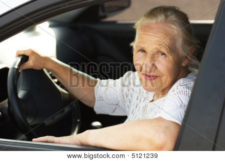Elderly Woman In The Car