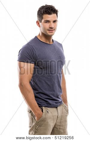 Handsome latin man smiling, isolated over a white background