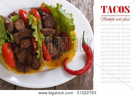 Mexican tacos with pepper silica on a wooden table.
