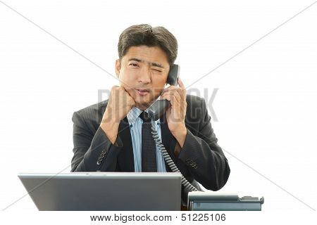 Stressed Asian businessman