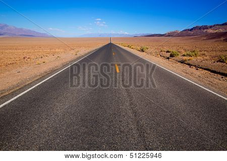 Badwater road Death Valley straight in desert to mountains National Park California