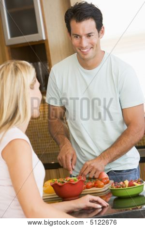 Husband And Wife Preparing Dinner