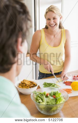 Woman Talking To Husband While Preparing Meal, Mealtime