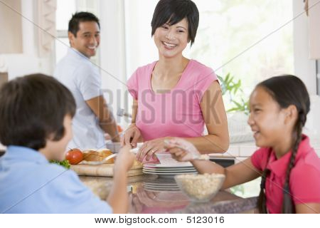 Family In The Kitchen Eating Breakfast