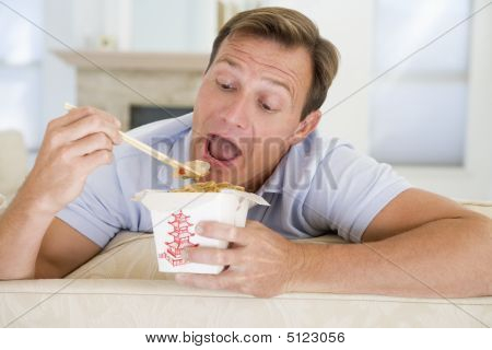 Man Eating Takeaways With Chopsticks