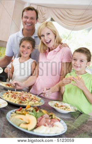Mother Serving Up Dinner For Family