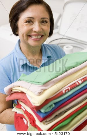 Woman Holding Folded Laundry